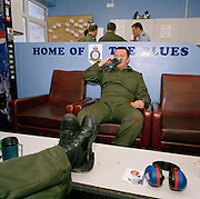 Engineering ground staff of the Red Arrows, Britain's RAF aerobatic team, relax in their crew room between training flights