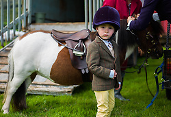 © Licensed to London News Pictures.29/08/15<br /> Bilsdale, UK. <br /> <br /> A young rider waits as his pony is prepared ahead of competing during the 105th Bilsdale Country Show in North Yorkshire.<br /> <br /> Photo credit : Ian Forsyth/LNP
