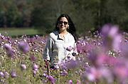 Woman in spring wild flowers.