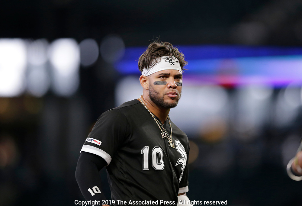 Chicago White Sox's Yoan Moncada waits on the field after he was called out against the Seattle Mariners during a baseball game, Sunday, Sept. 15, 2019, in Seattle. (AP Photo/John Froschauer)