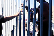 Tijuana 2015.<br /> The house of migrants has no space for the huge number of migrants, deported and refugees. Besides people with drugs problems are not accepted.<br /> <br /> Dalla casa delle migranti si offre acqua a chi non può ottenere ospitalità.