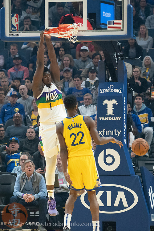 February 23, 2020; San Francisco, California, USA; New Orleans Pelicans forward Zion Williamson (1) dunks the basketball against Golden State Warriors guard Andrew Wiggins (22) during the second quarter at Chase Center.