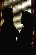 Couple age 20 silhouetted in window.  St Paul  Minnesota USA