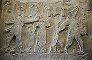 Rock Relief From Firaktin near the village of Gümüsören, Turkey.   king Hattusili III is also pouring a libation, a drink offering, to the Storm God god on the far left. 1275BC. A plaster cast from the Vorderasiatisches Museum, Pergamon Museum, Berlin .<br /> <br /> If you prefer to buy from our ALAMY PHOTO LIBRARY  Collection visit : https://www.alamy.com/portfolio/paul-williams-funkystock/yazilikaya-hittite-sanctuary-hattusa.html<br /> <br /> Visit our ANCIENT WORLD PHOTO COLLECTIONS for more photos to download or buy as wall art prints https://funkystock.photoshelter.com/gallery-collection/Ancient-World-Art-Antiquities-Historic-Sites-Pictures-Images-of/C00006u26yqSkDOM