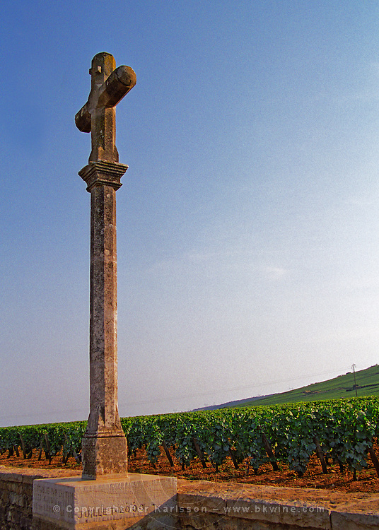 The famous stone cross marking the Grand Cru vineyards Romanee Conti and Richebourg, Vosne, Bourgogne
