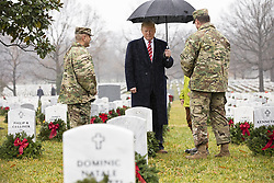 December 15, 2018 - Washington, DC, United States of America - U.S President Donald Trump walks through Arlington National Cemetery Section 60 with Army National Military Cemeteries and Arlington National Cemetery leadership during the annual Wreaths Across America event December 15, 2018 in Arlington, Virginia. (Credit Image: © Joyce N. Boghosian via ZUMA Wire)
