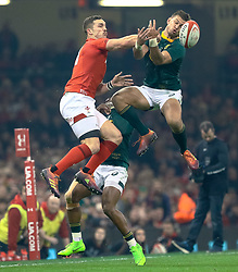 George North of Wales and Handre Pollard of South Africa vie for the high ball<br /> <br /> Photographer Simon King/Replay Images<br /> <br /> Under Armour Series - Wales v South Africa - Saturday 24th November 2018 - Principality Stadium - Cardiff<br /> <br /> World Copyright © Replay Images . All rights reserved. info@replayimages.co.uk - http://replayimages.co.uk
