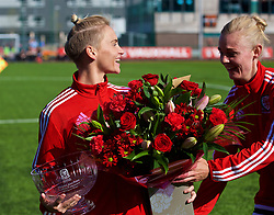 YSTRAD MYNACH, WALES - Wednesday, April 5, 2017: Wales' Jessica Fishlock receives flowers to mark her 100th cap from Sophie Ingle ahead of the Women's International Friendly match against Northern Ireland at Ystrad Mynach.(Pic by Laura Malkin/Propaganda)