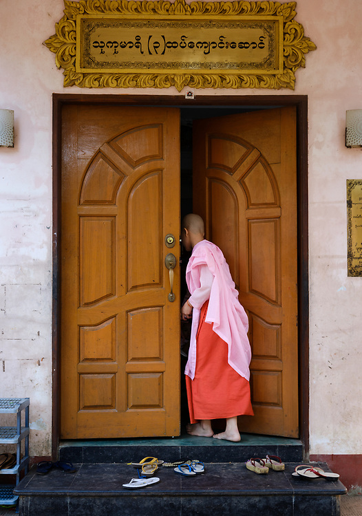 YANGON, MYANMAR - CIRCA DECEMBER 2017: Nun reading a book in Yangon