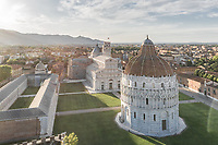 Aerial view of leaning tower of Pisa at sunrise in Italy.
