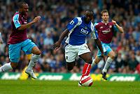 Photo: Alan Crowhurst.<br />Portsmouth v West Ham United. The Barclays Premiership. 14/10/2006. Lomana Tresor LuaLua of Portsmouth (R) burst through.