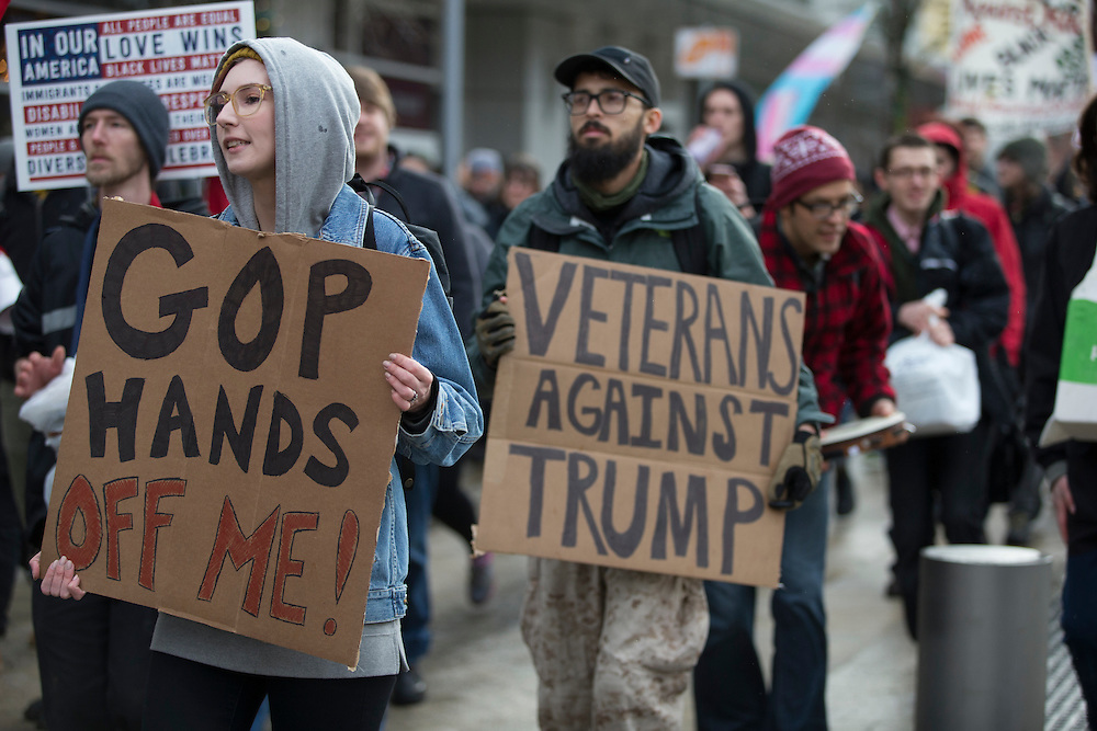 Portland State University students and others gathered on the school's campus for a protest against President-elect Donald Trump's inauguration Friday, Jan. 20, 2017. The group then marched to join a larger protest in downtown Portland, Ore.  Photo by Randy L. Rasmussen, © 2017.
