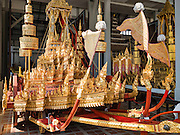 """19 DECEMBER 2016 - BANGKOK, THAILAND: A Thai Royal Chariot at the Bangkok National Museum. A """"Spirit Appeasing"""" Ceremony was held for the Royal Chariots at the Bangkok National Museum. The chariots will be used to take the body of Bhumibol Adulyadej, the Late King of Thailand, and members of the Royal funeral cortege to the cremation site on Sanam Luang for His Majesty's cremation. This will be the first cremation of a Thai King since 1950, when King Bumibol's brother, Rama VIII, Ananda Mahidol, was cremated. The design of the royal crematorium is based on Buddhist cosmology, with the main peak of Mount Sumeru (also known as Meru in Hindu cosmology) at center and eight other peaks signifying the levels of the universe. The crematorium will be decorated with mythical creatures such as garuda, angels, and Himmapan Forest creatures. The structure and funeral pyre will stand just over 50 meters tall. The exact date of the King's cremation has not been set yet but is expected to be late next year.     PHOTO BY JACK KURTZ"""