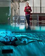 Krista Ingram, Associate Professor of Biology, stands for a portrait with swimmer Carolyn Silverman '20, November 21, 2019. Ingram studies circadian rhythms of student athletes.
