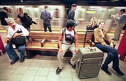 18 September 2001. New York, New York - USA.<br /> Post 9/11 World Trade Center attack.<br /> John Philips walks away from Wall Street, his belongings crammed into a suitcase as he becomes a refugee from his luxury apartment just 2 blocks from the site of the Twin Towers collapse. He took the subway to a friend's house where he has been offered a couch to sleep on. John was granted special permission to enter his once luxury apartment close to where the World Trade Center Twin Towers used to stand. His apartment is now filled with dust and debris from the collapsed towers. John and residents of the building were evacuated following the attack which cut off water and electricity supplies. A week after the attack, residents were given just 15 minutes to gather necessary belongings and leave their apartments which by default rendered them homeless, perhaps the first refugees of the War on Terror. Residents were warned to check their balconies for victims of the Twin Towers who might have fallen to their deaths.<br /> In the chaos of 9/11, John's sister Dr Sneha Ann Philip disappeared. John claimed she used to walk past the Twin Towers every morning on her way to work. He fears she might be a victim of the coordinated Al Qaeda attack which claimed over 2,000 victims at the site of the Twin Towers.<br /> It was later discovered that his sister was indeed one of the earliest victims killed in the attack.<br /> Photo exclusive©; Charlie Varley/varleypix.com