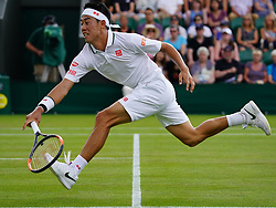 July 5, 2018 - London, England, U.S. - LONDON, ENG - JULY 05: Kei Nishikori (JPN) in action during his second round match on July 5, 2018 at the Wimbledon Championships, played at the All England Lawn Tennis and Croquet Club on July 05, 2018 in London, England. (Photo by Cynthia Lum/Icon Sportswire) (Credit Image: © Cynthia Lum/Icon SMI via ZUMA Press)