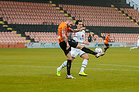 Football - 2020 / 2021 Emirates FA Cup - Round 2 - Barnet vs Milton Keynes Dons - The Hive<br /> <br /> James Dunne (Barnet FC) hooks the ball clear from George Williams (MK Dons) as Milton Keynes begin to find some rhythm<br /> <br /> COLORSPORT/DANIEL BEARHAM