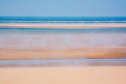 A sea fret adds texture to the stripes of Brancaster Beach, North Norfolk, East Anglia.