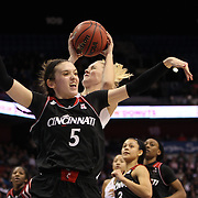 Courtney Ekmark, UConn, rebounds while challenged by Makenzie Cann, Cincinnati, during the UConn Vs Cincinnati Quarterfinal Basketball game at the American Women's College Basketball Championships 2015 at Mohegan Sun Arena, Uncasville, Connecticut, USA. 7th March 2015. Photo Tim Clayton