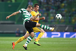 October 31, 2017 - Lisbon, Portugal - Sporting's defender Stefan Ristovsk from Macedonia (L) fights for the ball with Juventus' Croatian forward Mario Mandzukic during the UEFA Champions League football match Sporting CP vs Juventus at the Alvalade stadium in Lisbon, Portugal on October 31, 2017. (Credit Image: © Pedro Fiuza/NurPhoto via ZUMA Press)