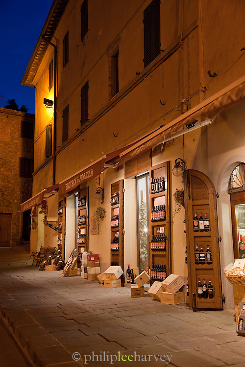 Shops at dusk selling the reknowned Brunello di Montalcino fine red wine in Montalcino, Tuscany, Italy