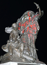 August 13, 2017 - Atlanta, Georgia, U.S. - Protesters marching from Woodruff Park to Piedmont Park during a anti white nationalism memorial and march in response to violence in Virginia, spray painted and tried to topple a Confederate monument with a chain on Sunday. The peace monument at the 14th Street entrance depicts a angel of peace stilling the hand of a Confederate soldier about to fire his rifle. (Credit Image: © Curtis Compton/TNS via ZUMA Wire)
