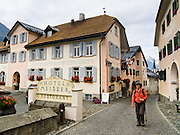 """The 1893 Hotel Meisser and Restorant and other architecture are well preserved in the 17th century town of Guarda, in Graubünden canton, Switzerland, the Alps, Europe. Guarda is one of the best preserved and characteristic villages of the Lower Engadine. The Swiss valley of Engadine translates as the """"garden of the En (or Inn) River"""" (Engadin in German, Engiadina in Romansh, Engadina in Italian). Walk the cobblestone streets for some Old World charm. For licensing options, please inquire."""