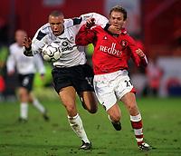 Mikael Silvestre (Man Utd) tangles with Jonatan Johansson (Charlton). Charlton Athletic v Manchester United. FA Premiership, 9/12/00. Credit: Colorsport / Andrew Cowie.