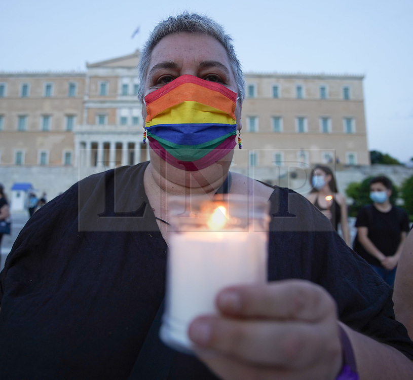 © Licensed to London News Pictures. 19/06/2021. Athens, Greece. A woman holds a candle outside the Hellenic Parliament in Athens as she takes part in a memorial service for the memory of Caroline Crouch.. Babis Anagnostopoulos confessed he killed his wife after she threatened to leave him and take their 11-month-old daughter with her following an argument. Photo credit: Ioannis Alexopoulos/LNP