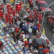 Injured spectators, track workers and rescue workers are seen after a horrific wreck involving driver Kyle Larson, that occurred on the last lap. .Debris scattered into the spectator grandstand area on the front stretch during a NASCAR Drive for COPD 300 race at Daytona International Speedway on Saturday, February 23, 2013 in Daytona Beach, Florida.  (Photo/Alex Menendez)