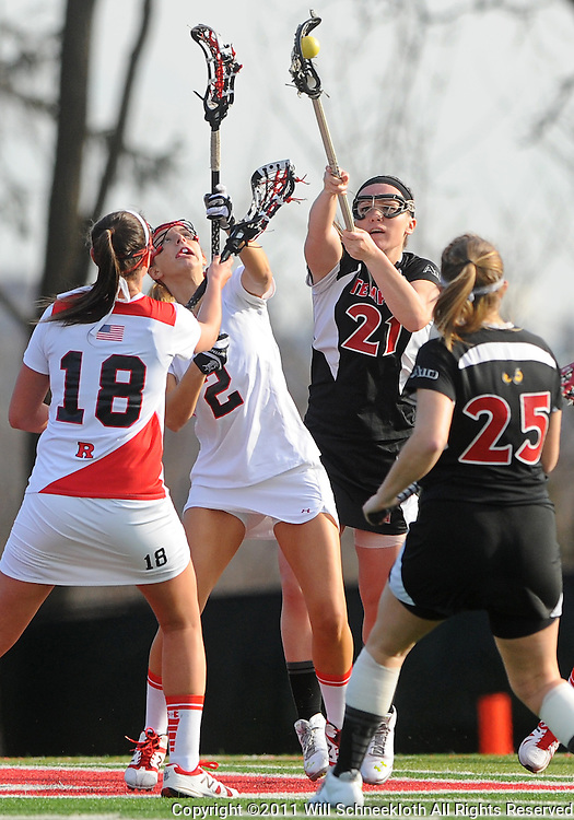Rutgers senior defender Rebecca Alley (2) and Temple senior midfielder Stephanie Markunas battle for a loose ball. Temple defeated Rutgers 12-11 in NCAA women's college lacrosse at the Rutgers Turf Field in Piscataway, N.J.