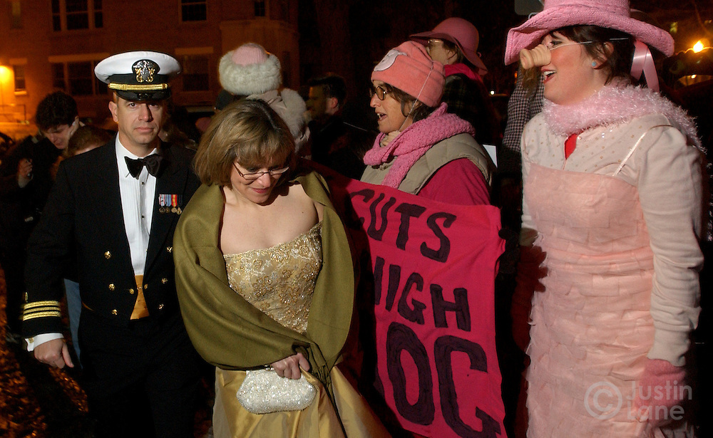 Two Protestors (R) heckle two guests (L) arriving for the Black Tie and Boots Inaugural Ball at a Marriott hotel in Washington DC where Republicans were gathering for a celebration and an appearance by United States President George W. Bush Wednesday 19 January 2005.