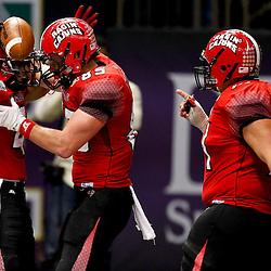 December 22, 2012; New Orleans, LA, USA; Louisiana-Lafayette Ragin Cajuns wide receiver Javone Lawson (4) celebrates after a touchdown catch with Louisiana-Lafayette Ragin Cajuns tight end Ian Thompson (85) and Louisiana-Lafayette Ragin Cajuns offensive linesman Andre Huval (71) during the second half of the New Orleans Bowl at the Mercedes-Benz Superdome. UL-Lafayette defeated East Carolina 43-34. Mandatory Credit: Derick E. Hingle-USA TODAY Sports
