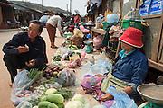 Mar. 13, 2009 -- VANG VIENG, LAOS: A shopper buys produce from a vendor in the Hmong market in Phou Khoun, Laos. Phou Khoun is about halfway between Vang Vieng and Luang Prabang.  Photo by Jack Kurtz