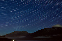 Night Sky and Star Trails looking northeast from Haines, Alaska. Composite of images from 23:00 to 23:29 taken with a Nikon D3x camera and 45 mm f/2.8 PC-E lens (ISO 400, 45 mm, f/5.6, 29 sec). Raw images processed with Capture One Pro and the composite generated using Photoshop CC (statistics, maximum).