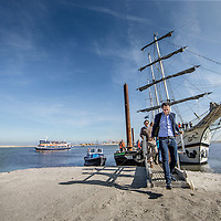 Nederland, Lelystad, 24 september 2016.<br /> Op zaterdag 24 september 2016 zet staatssecretaris Martijn van Dam van Economische Zaken (natuur) als eerste voet op de Marker Wadden. Natuurmonumenten legt samen met Rijkswaterstaat en Boskalis de komende jaren een archipel aan eilanden aan, die de natuur in het Markermeer een enorme impuls gaat geven. De staatssecretaris brengt samen met natuur- en watersportliefhebbers een bezoek aan het eerste eiland van dit innovatieve en grootschalige natuurproject. Dit eerste eiland omvat circa 250 hectare. De eerste fase van Marker Wadden omvat in totaal zo'n 800 hectare, boven- en onderwaternatuur, en moet klaar zijn in 2020.<br /> Op de foto: Staatsecretaris Martijn van Dam zet voet aan de grond van de eerste Marker eiland.<br /> <br /> Netherlands, Lelystad, September 24, 2016<br /> On Saturday, September 24th 2016 Martijn van Dam, secretary of Economic Affairs (nature) first sets foot on the Marker Wadden. Natuurmonumenten lays together with Rijkswaterstaat and Boskalis (Royal Boskalis Westminster N.V. is a leading global services provider operating in the dredging, maritime infrastructure and maritime services sectors) an archipelago of islands in the coming years that will give nature in the Markermeer a huge boost.<br /> Natuurmonumenten (Dutch Society for Nature Conservation) is going to restore one of the largest freshwater lakes in western Europe by constructing islands, marshes and mud flats from the sediments that have accumulated in the lake in recent decades. These 'Marker Wadden' will form a unique ecosystem that will boost biodiversity in the Netherlands. (source: www.natuurmonumenten.nl)<br /> The Secretary reunites with nature and water sports enthusiasts visiting the first island of this innovative and large-scale conservation project. This first island comprises approximately 250 hectares. The first phase of Marker Wadden comprises a total of 800 hectares, above and underwater nature, and should be ready in 2020.<br /> In the photo: Minister Martijn van D