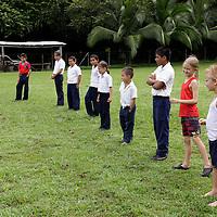 Central America, Costa Rica, Puerto Jiminez. Kids getting exercise at Esculea Carbonera, a small school nearby Lapa Rios.