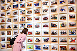 "© Licensed to London News Pictures. 11/11/2019. LONDON, UK. A visitor views works at the preview of ""Year 3"", an exhibition by Turner Prize-winning artist and Oscar-winning filmmaker Steve McQueen at Tate Britain.  The artwork comprises 3,128 traditional school class photographs of Year 3 pupils from 1,504 of London's primary schools.  The work reflects a picture of the present and is on display 12 November to 3 May 2020.  Photo credit: Stephen Chung/LNP"