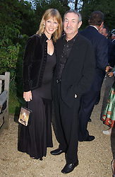 NICK & NETTE MASON at the annual Cartier Flower Show Diner held at The Physics Garden, Chelsea, London on 23rd May 2005.<br />