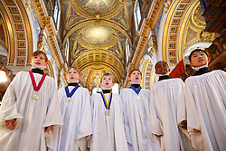 © licensed to London News Pictures. London, UK 09/12/2013. The choristers of St Paul's Cathedral rehearsing ahead of numerous services and concerts throughout December and the Christmas. Photo credit: Tolga Akmen/LNP