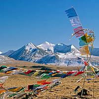 Himalaya, Tibet, China. Tibetan Buddhist prayer flags atop pass on Tibetan plateau.