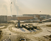 A coal-fired power plant located on the edge of the city. Burning fossil fuels is the primary source of both climate-warming emissions and health-damaging air pollution.<br /> Mongolia