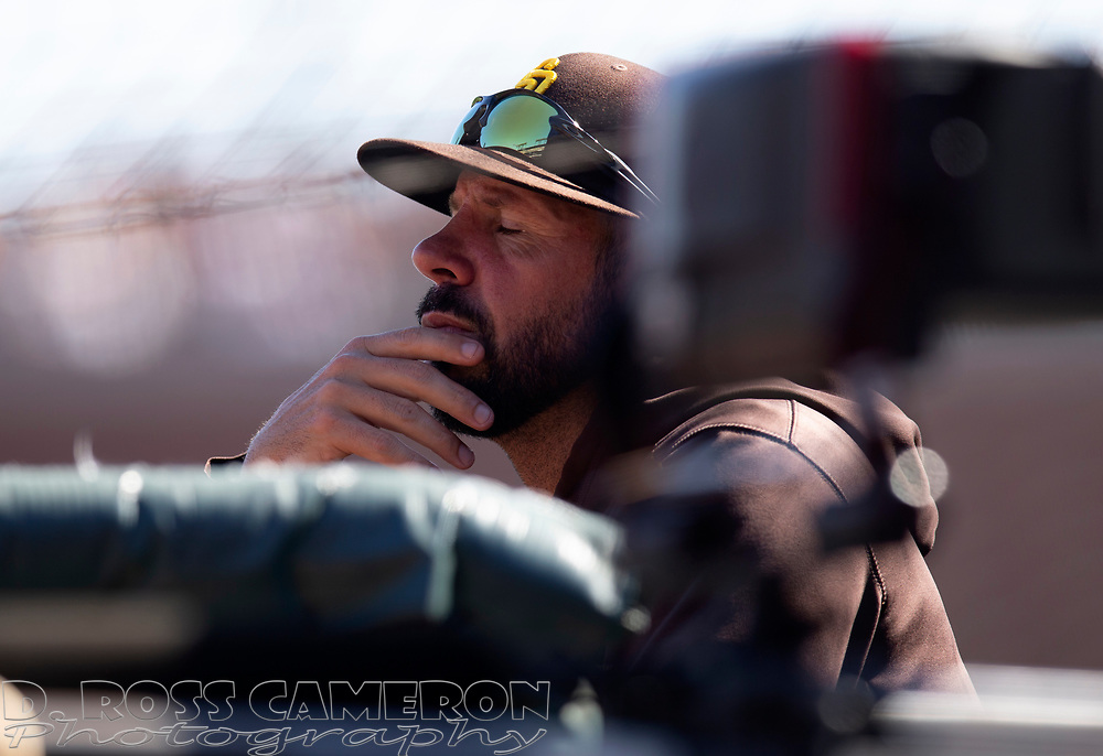 Oct 3, 2021; San Francisco, California, USA; San Diego Padres manager Jayce Tingler (32) watches his team take on the San Francisco Giants during the fourth inning at Oracle Park. Mandatory Credit: D. Ross Cameron-USA TODAY Sports
