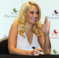 © Licensed to London News Pictures. 26/09/2012.Singer and X-factor judge Tulisa Contostavlos at Bluewater shopping Complex in Kent for her book signing this evening (26.09.2012). Her new book is called  My Story So Far..Photo credit : Grant Falvey/LNP