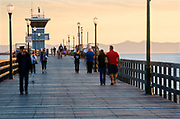 People Walking on the Seal Beach Pier