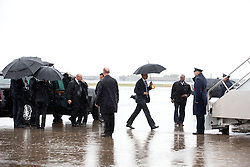 President Barack Obama carries an umbrella to board Air Force One at Charlotte Douglas International Airport prior to departure from Charlotte, N.C., April 15, 2015. (Official White House Photo by Amanda Lucidon)<br /> <br /> This official White House photograph is being made available only for publication by news organizations and/or for personal use printing by the subject(s) of the photograph. The photograph may not be manipulated in any way and may not be used in commercial or political materials, advertisements, emails, products, promotions that in any way suggests approval or endorsement of the President, the First Family, or the White House.