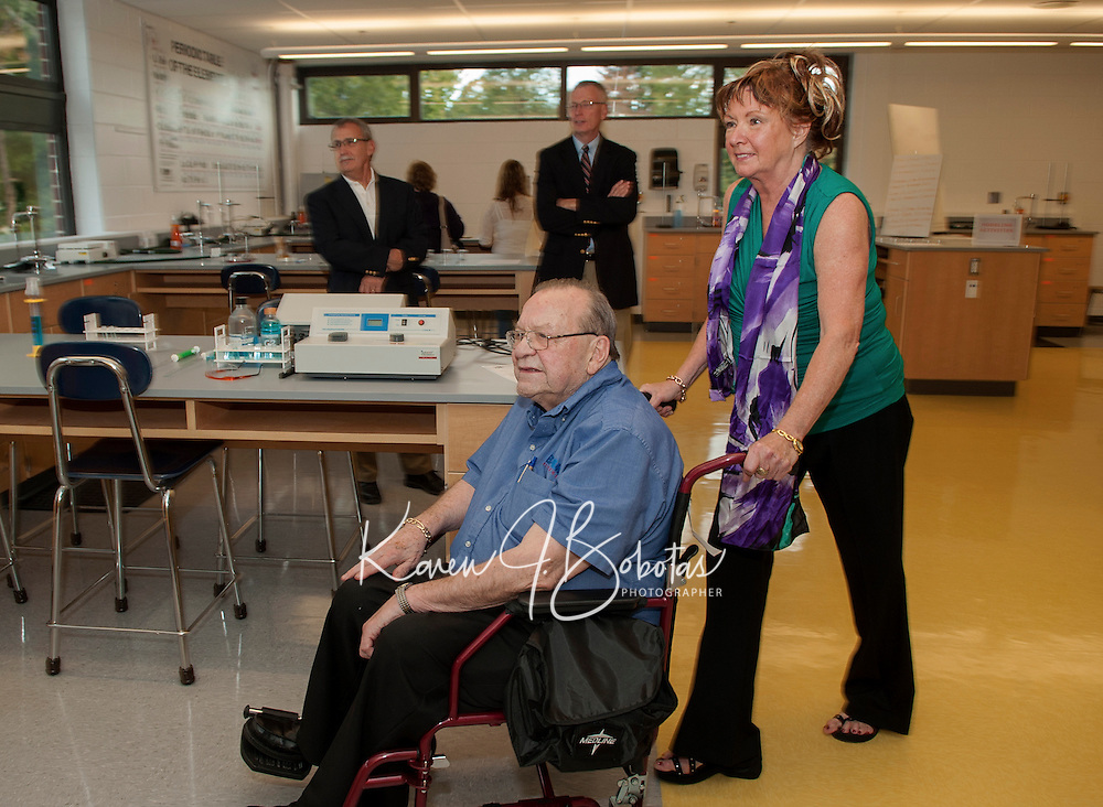 """Dick Dearborn and Sue """"Dearborn"""" Monza are among the visitors getting a tour of the new Science Department at Laconia High School Thursday evening.  (Karen Bobotas/for the Laconia Daily Sun)"""