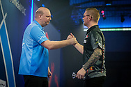 Vincent van der Voort (Netherlands) congratulated by Ron Meulenkamp (Netherlands) during the William Hill World Darts Championship at Alexandra Palace, London, United Kingdom on 20 December 2020.