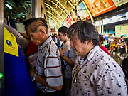 11 APRIL 2018 - BANGKOK, THAILAND:  People board a train at Hua Lamphong train station in Bangkok on the first day of the Songkran travel period. Songkran is the traditional Thai New Year and is one of the busiest travel periods of the year as Thais leave the capital and go back to their home provinces or resorts in tourist areas. Trains and busses are typically jammed the day before the three day Songkran holiday starts. The government has extended the official holiday period through Monday, 16 April because one day of the Songkran holiday fell on the weekend, giving many workers a five day holiday.      PHOTO BY JACK KURTZ