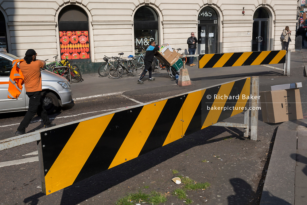 Yellow and black striped security barrier at the side of Victoria mainline station, on 15th April 2019, in London, England.